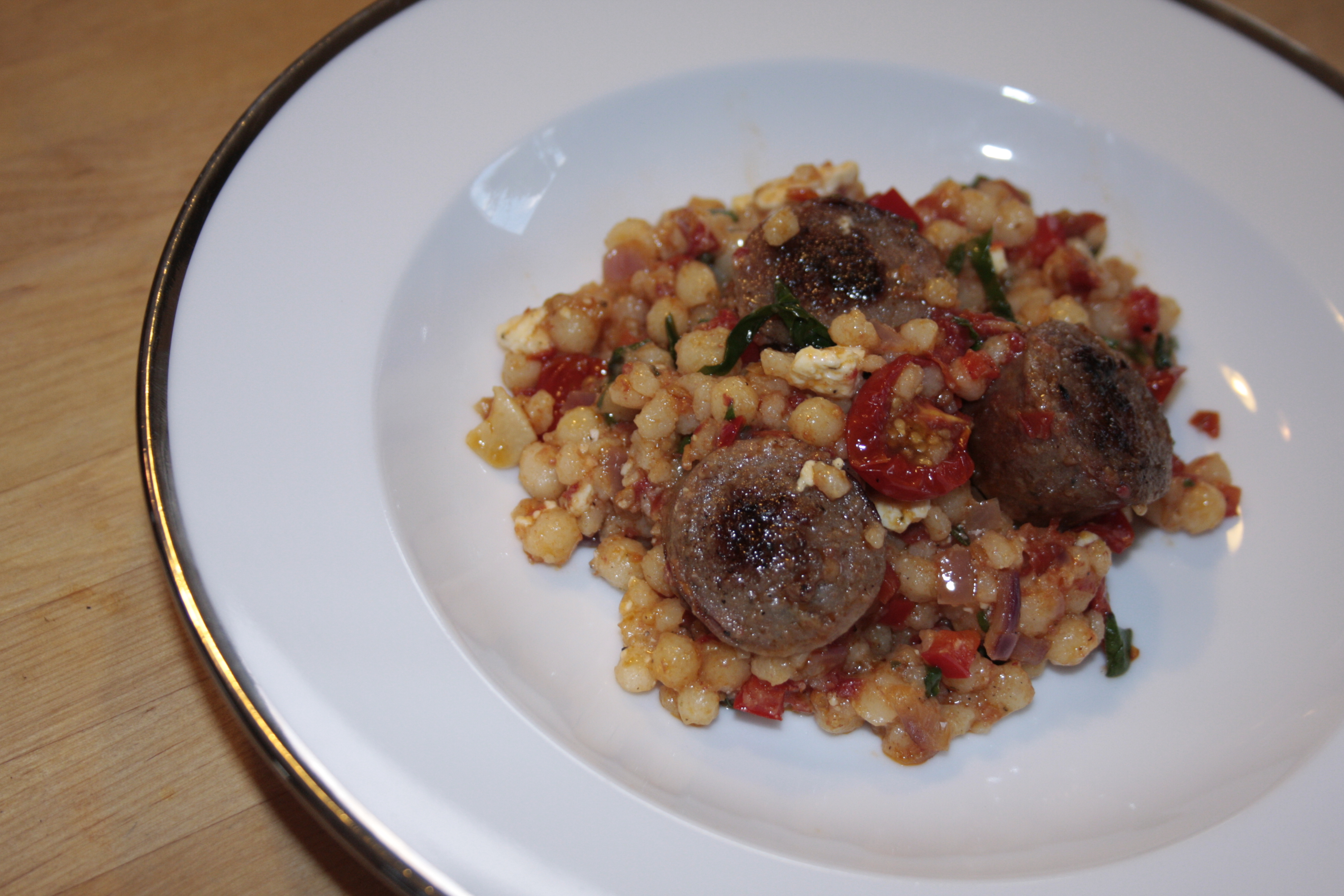 slow roasted tomato couscous with chicken sausage feta and basil
