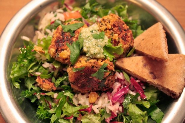 green tahini dressing on falafel salad